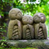 Little statues in Japanese garden