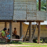 Lao people under a cabin in the shadow