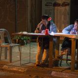 People selling Tickets in Vang Vieng