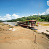 Our Longboat at the shore of the Mekong