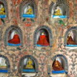 Little Buddha statues in temple wall
