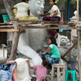 Workers making new budha statue