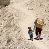 Kid and woman on mountain path