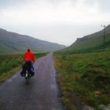 Girl cycling at the Isle of Mull