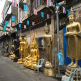 Budda statues for sale, in a street