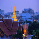 Spine of a gold stupa in the skyline of Bangkok