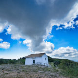 White cabin with clouds